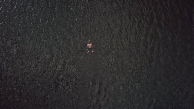 aerial views of a person swimming in the river thames - shirtless stock videos & royalty-free footage
