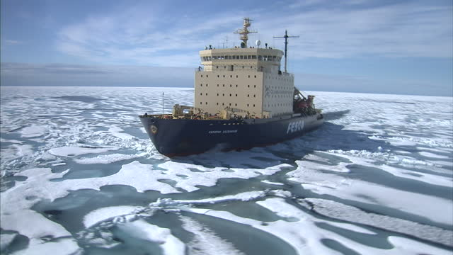 clean aerial views of a quark expeditions fesco icebreaker moving through ice floes in the north west passage on august 25 2007 in cambridge bay... - northwest passage stock videos and b-roll footage