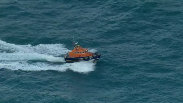 aerial views of a rnli lifeboat sailing at sea towards the isle of guernsey - guernsey stock videos & royalty-free footage