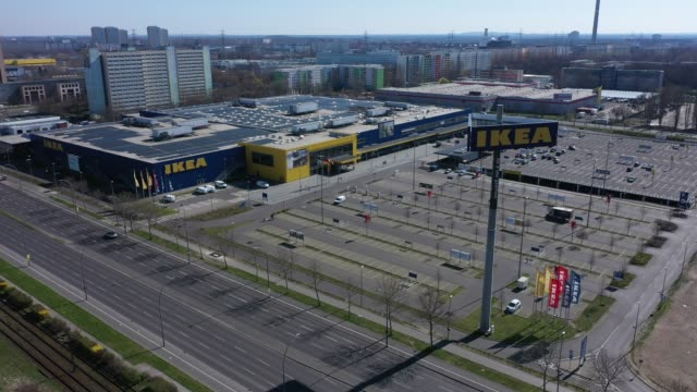aerial views of an empty parking of a temporarily shuttered ikea home furnishings store on march 24, 2020 in berlin, germany. the coronavirus and the... - fensterladen stock-videos und b-roll-filmmaterial