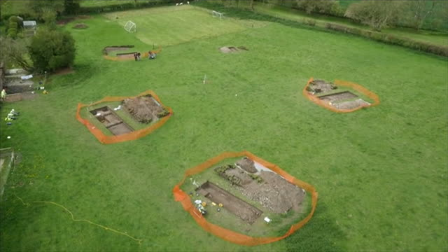 aerial views of an excavation site after a roman villa was discovered beneath farmland in wiltshire - digging stock videos & royalty-free footage