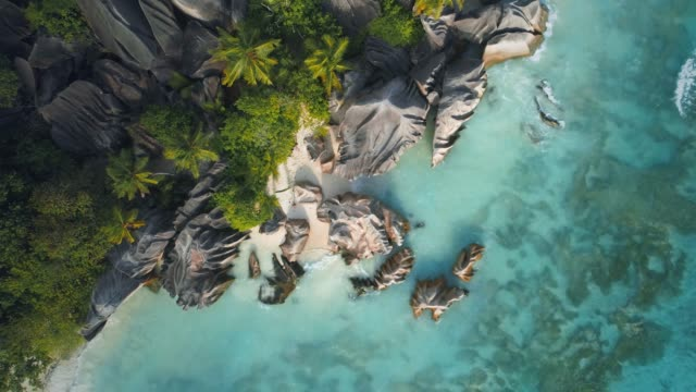 aerial views of anse source d'argent - seychelles stock videos & royalty-free footage