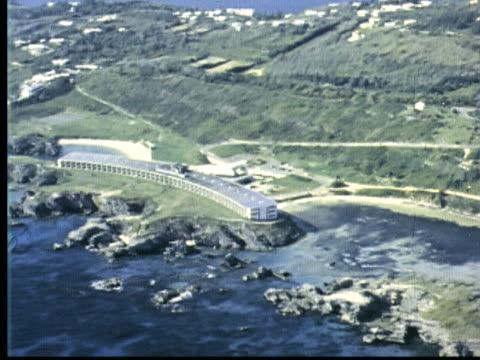 1963 montage aerial views of bermuda hotels. elbow beach hotel, wyndham bermuda resort, guest house, cottage colony / bermuda - bermuda stock videos & royalty-free footage