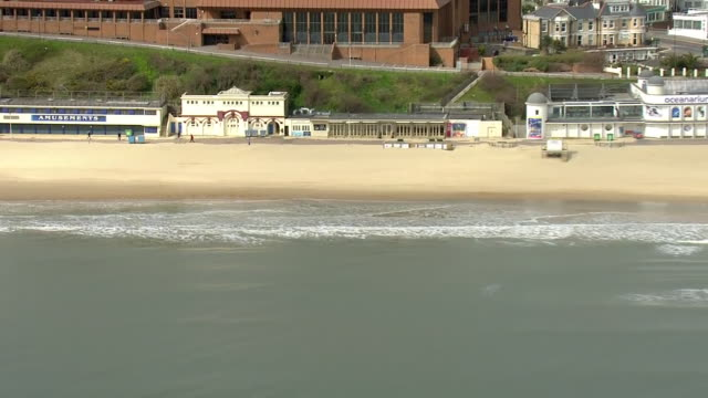 aerial views of bournemouth bournemouth pier and empty beach and streets during the coronavirus epidemic on 30th march 2020 bournemouth united kingdom - bournemouth stock-videos und b-roll-filmmaterial