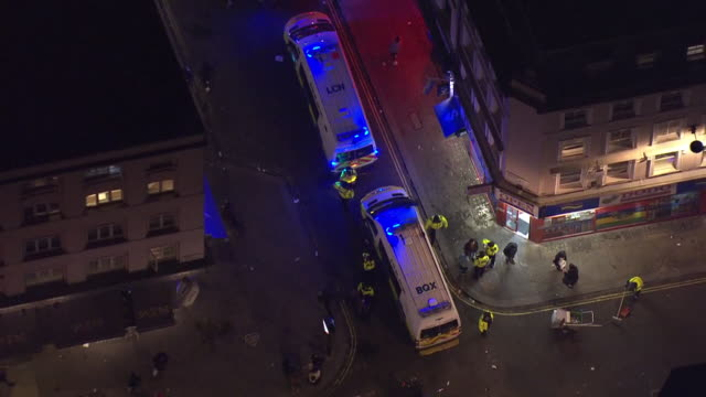 aerial views of british police vans out on streets near soho responding to an incident on 4th november 2020 london, united kingdom. - aerial view stock videos & royalty-free footage
