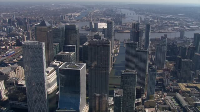 aerial views of canary wharf and the isle of dogs surrounded by empty streets during the coronavirus outbreak and lockdown on 25th march 2020 london... - office block exterior stock videos & royalty-free footage