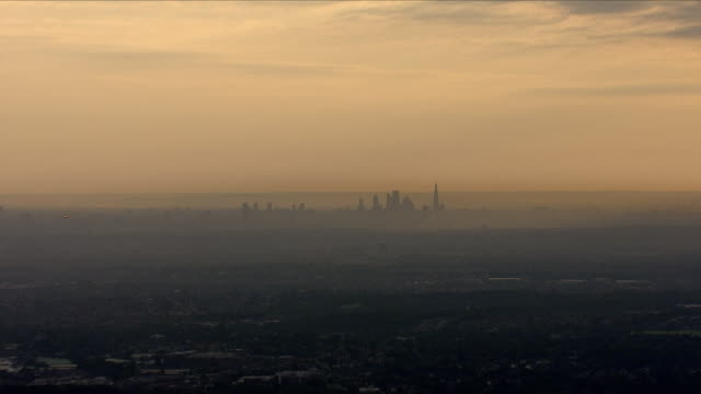 aerial views of central london skyline with air pollution - smog stock videos & royalty-free footage