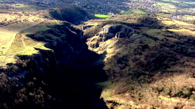 aerial views of cheddar gorge in the mendip hills and the village of cheddar.>> on february 07, 2018 in cheddar, england. - cheddar gorge stock videos & royalty-free footage