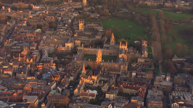 aerial views of christ church and tom tower and surrounding buildings on 23 november 2020 in oxford, united kingdom - oxford england stock videos & royalty-free footage