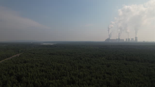 aerial views of coal-fired belchatow power station, in belchatow, lodzkie, poland on thursday, july 8, 2021. the coal-fired power station is the... - smoke stack stock videos & royalty-free footage