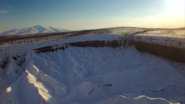 aerial views of crater caused by melting permafrost - melting stock videos & royalty-free footage