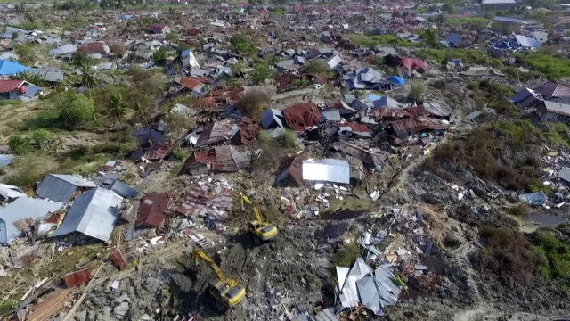 aerial views of destruction caused by a devastating earthquake and tsunami on the indonesian island of sulawesi - indonesia video stock e b–roll