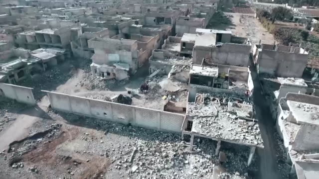 aerial views of destruction caused by air strikes in eastern ghouta syria - syrien stock-videos und b-roll-filmmaterial