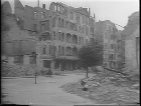 vidéos et rushes de aerial views of devastated and wrecked postwar berlin / streetlevel views of devastated and wrecked postwar berlin - 1945