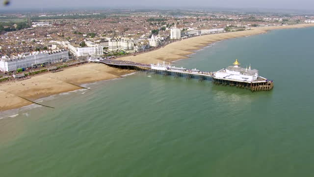 aerial views of eastbourne beach and pier on the hottest september day since 1911 on september 13 2016 in eastbourne england - tropical climate stock videos & royalty-free footage