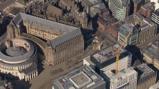 stockvideo's en b-roll-footage met aerial views of empty roads and streets around manchester central library and manchester city council during the coronavirus outbreak and lockdown on... - stilstaande camera