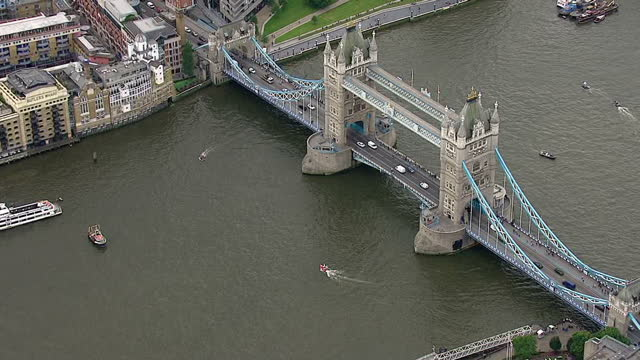aerial views of fishing for leave eu referendum campaign boat circling around tower bridge and small in campaign boat circling around them in the... - 2016 european union referendum stock videos and b-roll footage