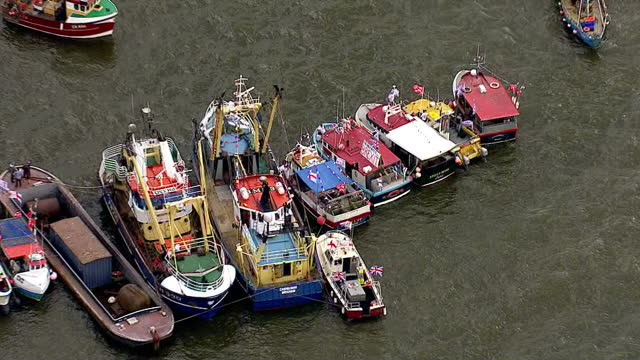 aerial views of fishing for leave eu referendum campaign boats moored together on the river thames on june 15 2016 in london united kingdom the... - 2016 european union referendum stock videos and b-roll footage