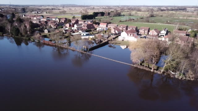 aerial views of flooding in ironbridge - house stock videos & royalty-free footage