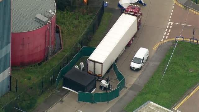 aerial views of forensics teams searching for evidence around a refrigerated lorry which contained 39 dead bodies - teamwork stock videos & royalty-free footage