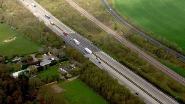 aerial views of freight lorries driving on a motorway - road stock videos & royalty-free footage