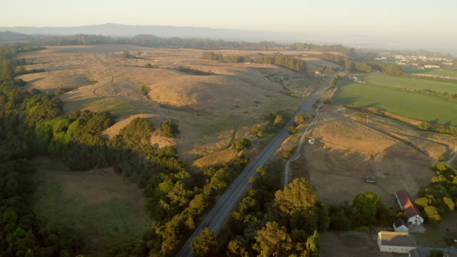 aerial views of highway 1 at sunset close to santa cruz, california. - route 001 stock videos & royalty-free footage