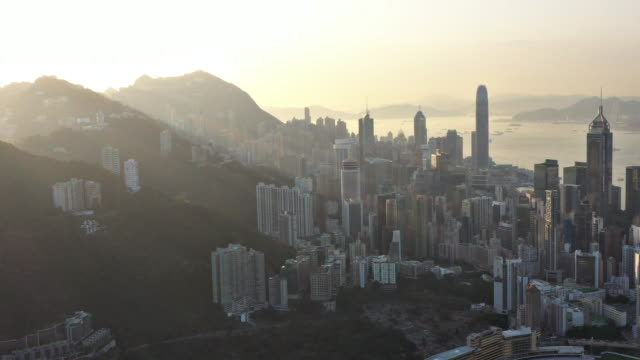 aerial views of hong kong at sunrise - tourism stock videos & royalty-free footage