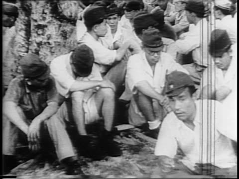 aerial views of hong kong / montage of british troops shooting at enemy snipers, japanese soldiers surrendering, chinese civilians looking through... - civilian stock videos & royalty-free footage