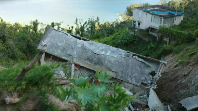 vídeos de stock, filmes e b-roll de aerial views of houses destroyed by hurricane maria in morovis puerto rico - porto riquenho