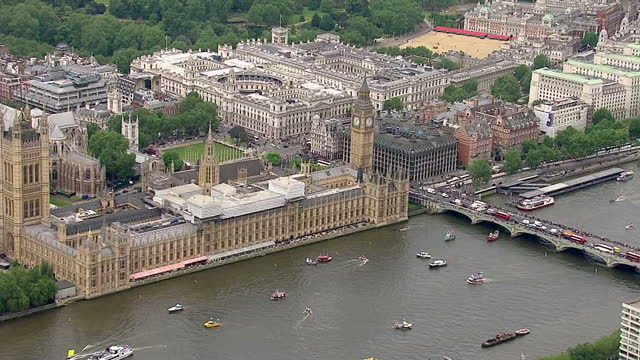 aerial views of houses of parliament and vote leave vote remain campaign boats circling around in the river thames outside it on june 15 2016 in... - 2016 european union referendum stock videos and b-roll footage
