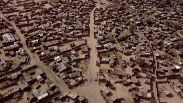 aerial views of kalma refugee camp in darfur sudan - スーダン点の映像素材/bロール