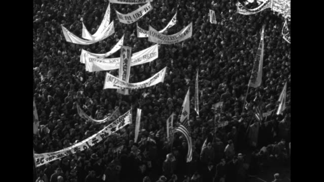 aerial views of large assembly in seoul with welcome banners as south koreans wait for a glimpse of us president-elect dwight eisenhower / note:... - koreanskt ursprung bildbanksvideor och videomaterial från bakom kulisserna