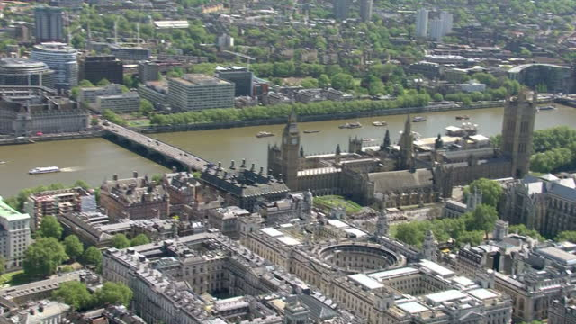 Aerial views of London skyline with River thames London Eye and pan to the city on a sunny day on May 13 2015 in London England