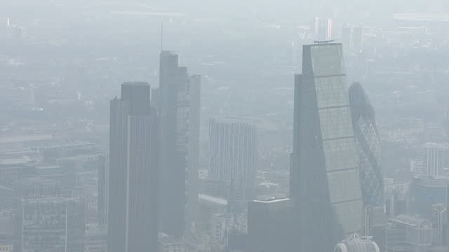 Aerial views of London with signs of Air Pollution and heavy smog Includes shots of the Cheesegrater skyscraper and the Gherkin on April 10 2015 in...
