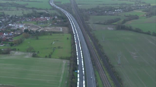 aerial views of lorries queuing near dover, stranded due to coronavirus travel restrictions in france - traffic stock videos & royalty-free footage