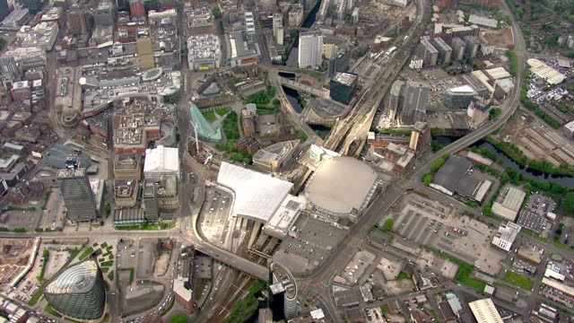 aerial views of manchester arena and police cordon after suicide bomber targeted an ariana grande concert 22 people and injured 59 others on 23rd may... - manchester arena stock videos & royalty-free footage