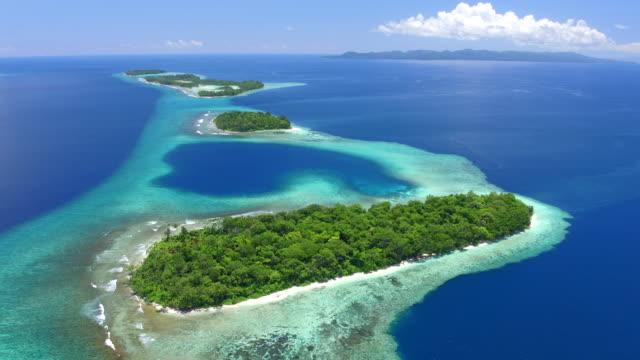 aerial views of marovo lagoon - pacific islands stock videos & royalty-free footage