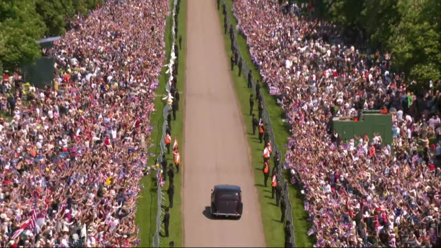 aerial views of meghan markle's car approaching windsor castle on the day of her wedding to prince harry - 2018 stock videos & royalty-free footage