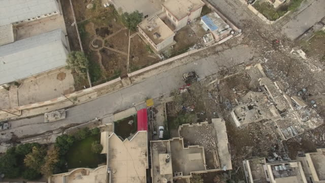 aerial views of mosul including explosions and the aftermath of fighting between iraqi government forces and islamic state militants - mosul stock videos and b-roll footage