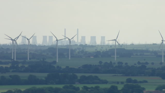 aerial views of rusholme wind farm and wind turbines with drax power station coalfired power station in background on june 24 2019 selby england - vapor stock videos & royalty-free footage