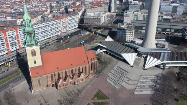 aerial views of saint mary's church standing at nearly empty alexanderplatz on march 24, 2020 in berlin, germany. the coronavirus and the disease it... - alexanderplatz stock videos & royalty-free footage