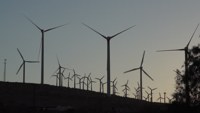 aerial views of san gorgonio pass wind farm in whitewater and palm springs. located in one of the windiest locations in the u.s., the san gorgonio... - large group of objects stock videos & royalty-free footage
