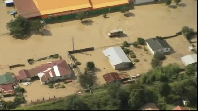 aerial views of severe flooding in town of edgecumbe with new zealand army truck travelling along flooded road with submerged buildings at roadside - extreme weather stock videos & royalty-free footage