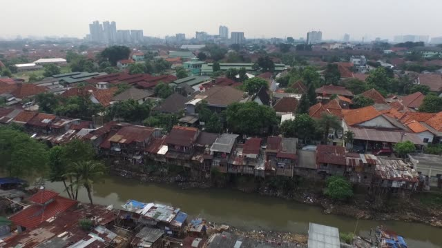 aerial views of shanty houses perched on stilts along a river in jakarta indonesia on tuesday june 23 2015 - stilts stock videos and b-roll footage