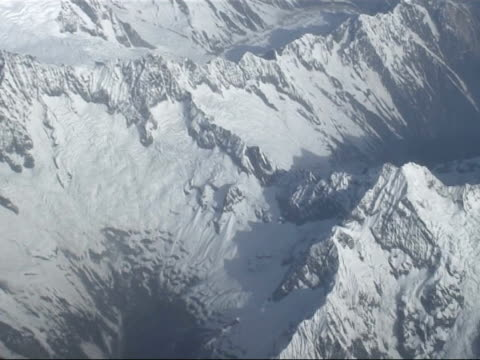 aerial views of snow capped mountains around everest; himilaya mountans: ext **camerawork shaky due to filming conditions** air views / aerials of... - shaky stock videos & royalty-free footage