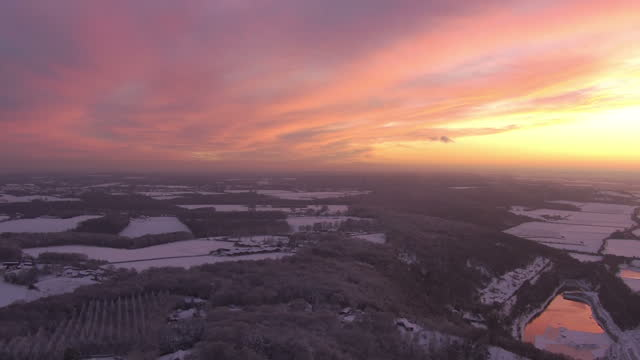 aerial views of sun setting over snow covered fields on 12th december 2017 oxfordshire, england. - oxfordshire stock videos & royalty-free footage