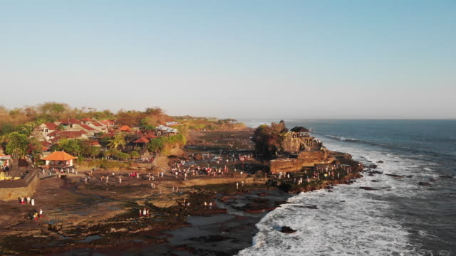 aerial views of tanah lot temple - bali, indonesia - indonesia stock videos & royalty-free footage