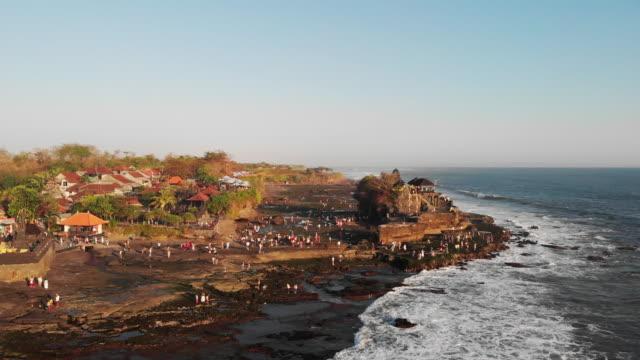 aerial views of tanah lot temple - bali, indonesia - indonesia landmark stock videos & royalty-free footage