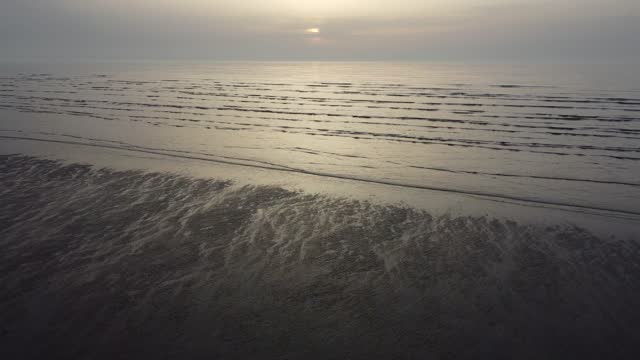 aerial views of the beach at berrow near burnham-on-sea as the sun sets over the sea in the bristol channel on march 27, 2021 in somerset, england.... - sunlight stock videos & royalty-free footage