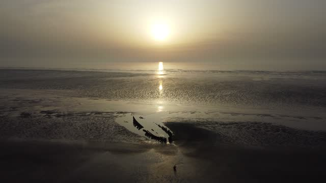 aerial views of the beach at berrow near burnham-on-sea as the sun sets over the sea in the bristol channel on march 27, 2021 in somerset, england.... - wave pattern stock videos & royalty-free footage